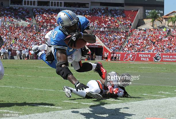 Wide receiver Nate Burleson of the Detroit Lions dives toward the endzone during the season opener against the Tampa Bay Buccaneers at Raymond James...