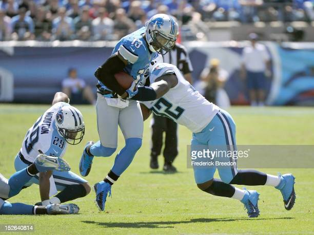 Wide receiver Nate Burleson of the Detroit Lions is tackled by Will Witherspoon of the Tennessee Titans at LP Field on September 23 2012 in Nashville...