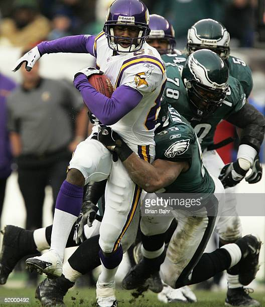 Wide receiver Nate Burleson of the Minnesota Vikings can't escape the tackle of Dhani Jones of the Philadelphia Eagles in an NFC divisional playoff...