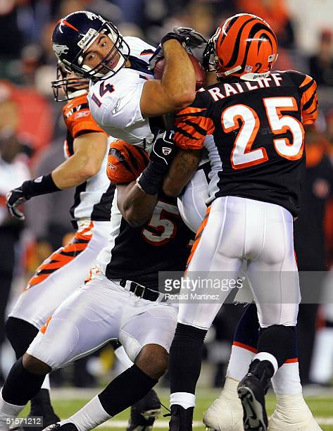 Wide receiver Nate Jackson of the Denver Broncos is tackled by Keiwan Ratliff, Kevin Hardy and Kevin Kaesviharn of the Cincinnati Bengals on October...