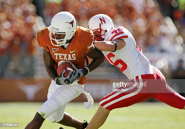 Wide receiver Nate Jones of the Texas Longhorns gets pushed out by safety Ben Eisenhart of the Nebraska Cornhuskers in the first half at Darrell K...