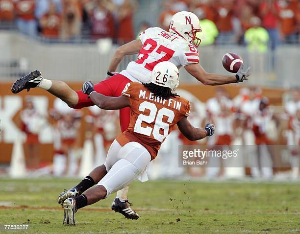 Wide receiver Nate Swift of the Nebraska Cornhuskers tries to catch a pass onehanded against safety Marcus Griffin of the Texas Longhorns at Darrell...