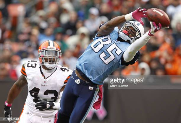 Wide receiver Nate Washington of the Tennessee Titans makes a catch in front of defensive back TJ Ward of the Cleveland Browns at Cleveland Browns...
