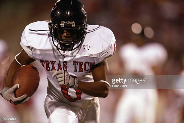 Wide receiver Nehemiah Glover of the Texas Tech University Red Raiders carries the ball during against the University of Oklahoma Sooners during the...