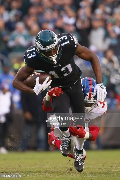 Wide receiver Nelson Agholor of the Philadelphia Eagles catches a fourthdown pass for a firstdown and is tackled by free safety Curtis Riley of the...