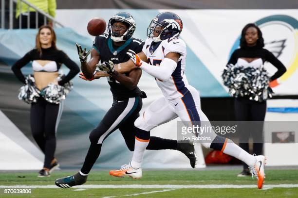 Wide receiver Nelson Agholor of the Philadelphia Eagles mkaes a catch against cornerback Chris Harris of the Denver Broncos during the fourth quarter...