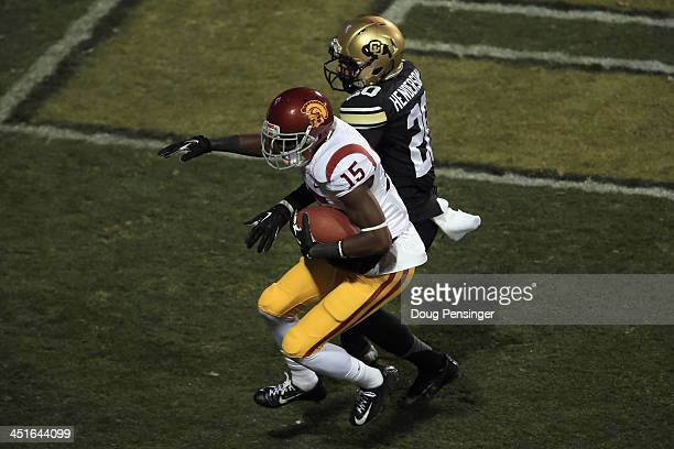 Wide receiver Nelson Agholor of the USC Trojans makes a touchdown reception against defensive back Greg Henderson of the Colorado Buffaloes to give...