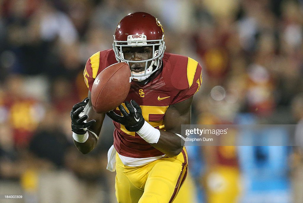 Wide receiver Nelson Agholor #15 of the USC Trojans makes the catch on a 62 yard touchdown pass play in the first quarter against the Arizona Wildcats at Los Angeles Coliseum on October 10, 2013 in Los Angeles, California.