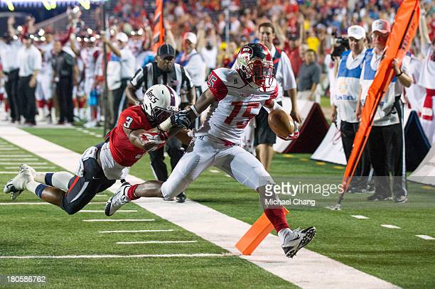 Wide receiver Nicholas Norris of the Western Kentucky Hilltoppers runs the ball in for a touchdown in front of safety Charles Watson of the South...