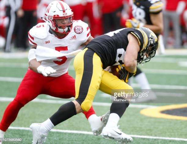 Wide receiver Nick Easley of the Iowa Hawkeyes catches a pass during the first half in front of linebacker Dedrick Young of the Nebraska Cornhuskers...