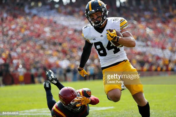 Wide receiver Nick Easley of the Iowa Hawkeyes drives in a touchdown as defensive back Evrett Edwards of the Iowa State Cyclones blocks in the first...