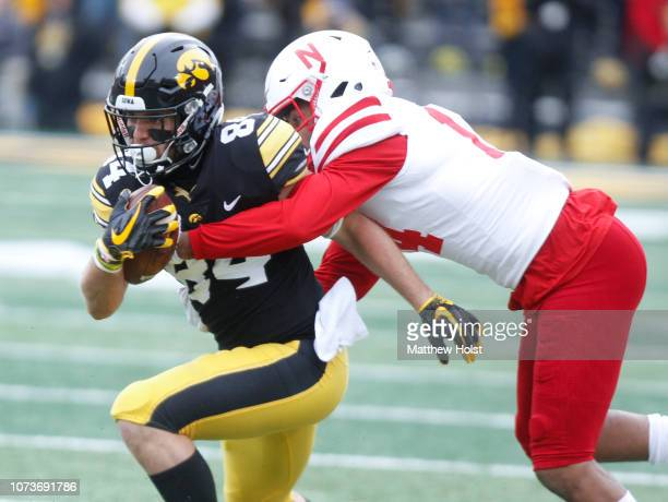Wide receiver Nick Easley of the Iowa Hawkeyes is tackled during the first half by safety Tre Neal of the Nebraska Cornhuskers on November 23 2018 at...