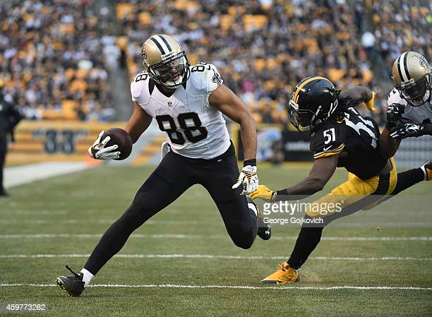 Wide receiver Nick Toon of the New Orleans Saints is pursued by linebacker Sean Spence of the Pittsburgh Steelers as he scores a touchdown on an...