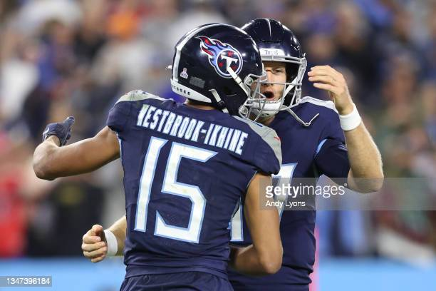 Wide receiver Nick Westbrook-Ikhine and quarterback Ryan Tannehill of the Tennessee Titans celebrate against the Buffalo Bills during the second half...