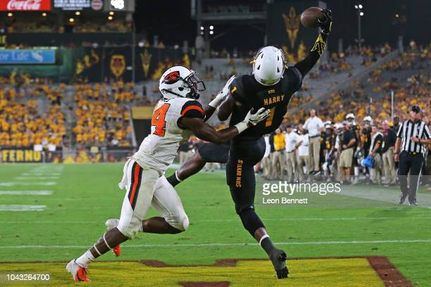Wide receiver N'Keal Harry of the Arizona State Sun Devils attempted catch against Oregon State Beavers defender at Sun Devil Stadium on September 29...
