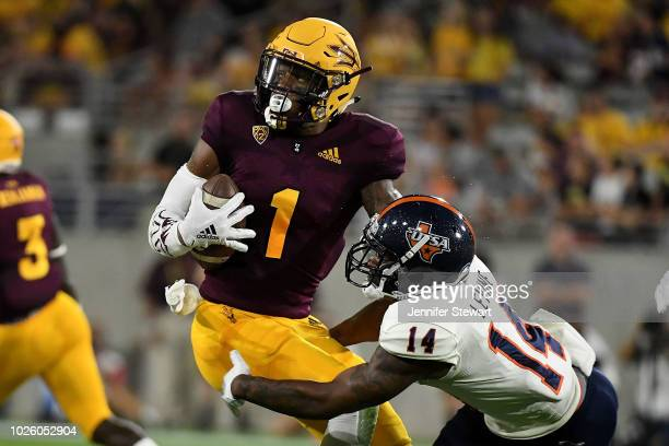 Wide receiver N'Keal Harry of the Arizona State Sun Devils breaks the tackle by safety CJ Levine of the UTSA Roadrunners to score a 58 yard touchdown...