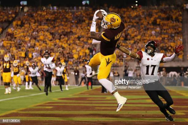 Wide receiver N'Keal Harry of the Arizona State Sun Devils catches a five yard touchdown pass against cornerback Ron Smith of the San Diego State...