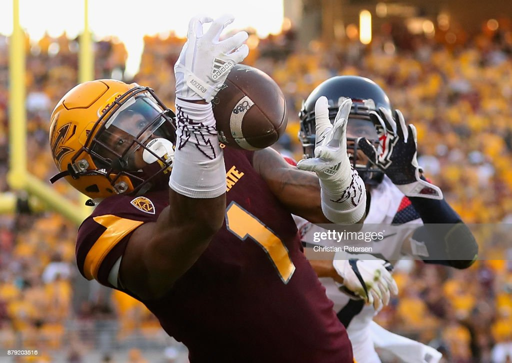 Wide receiver N'Keal Harry #1 of the Arizona State Sun Devils catches a five yard touchdown reception ahead of cornerback Jace Whittaker #17 of the Arizona Wildcats during the second half of the college football game at Sun Devil Stadium on November 25, 2017 in Tempe, Arizona. The Sun Devils defeated the Wildcats 42-30.