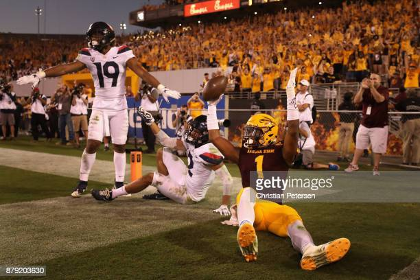 Wide receiver N'Keal Harry of the Arizona State Sun Devils celebrates after catching a nine yard touchdown reception against safety Scottie Young Jr...