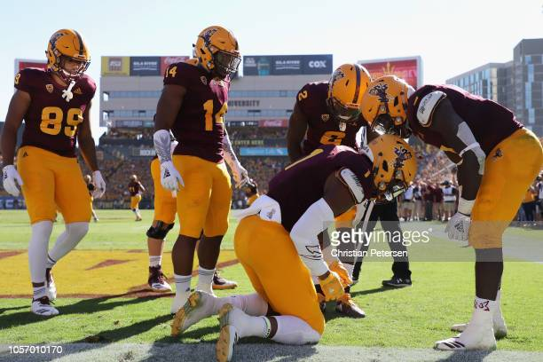 Wide receiver N'Keal Harry of the Arizona State Sun Devils is congratulated by running back Eno Benjamin after scoring a touchdown reception against...