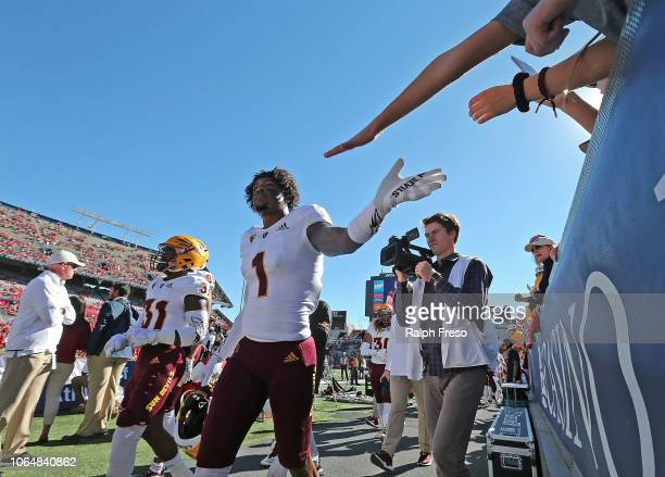 Wide receiver N'Keal Harry of the Arizona State Sun Devils is greeted by fans prior to a college football game against the Arizona Wildcats at...