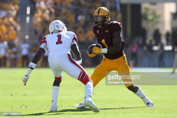 Wide receiver N'Keal Harry of the Arizona State Sun Devils runs with the football after a reception against defensive back Jaylon Johnson of the Utah...
