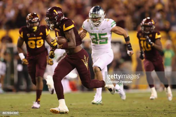 Wide receiver N'Keal Harry of the Arizona State Sun Devils runs with the football past defensive back Brady Breeze of the Oregon Ducks during the...