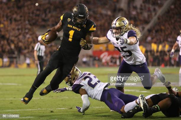 Wide receiver N'Keal Harry of the Arizona State Sun Devils runs with the football after a reception past defensive back Jordan Miller and linebacker...