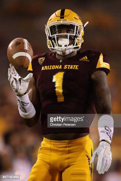 Wide receiver N'Keal Harry of the Arizona State Sun Devils warms up before the college football game against the San Diego State Aztecs at Sun Devil...