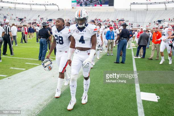 Wide receiver Noah Igbinoghene of the Auburn Tigers and running back JaTarvious Whitlow of the Auburn Tigers lead their team off the field prior to...