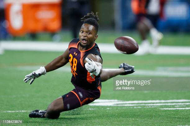 Wide receiver Noonie Murray of Florida State tries to hang onto a pass during day three of the NFL Combine at Lucas Oil Stadium on March 2 2019 in...