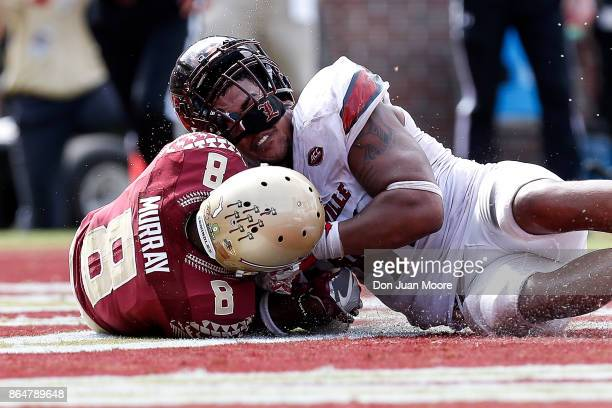 Wide Receiver Nyqwan Murray of the Florida State Seminoles recovers a loose ball for a score over Defensive End Trevon Young of the Louisville...
