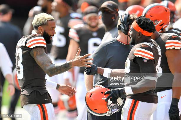 Wide receiver Odell Beckham Jr. #13 celebrates with strong safety Karl Joseph of the Cleveland Browns after Joseph after Joseph caught an...