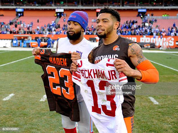 Wide receiver Odell Beckham Jr #13 of the New York Giants and cornerback Joe Haden of the Cleveland Browns pose for a picture after swapping jersies...