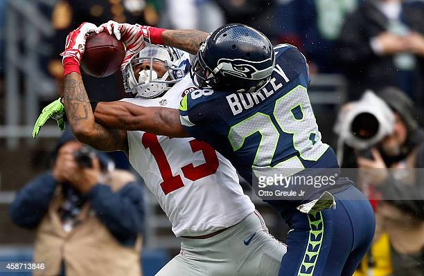 Wide receiver Odell Beckham Jr. #13 of the New York Giants catches a pass on defensive back Marcus Burley of the Seattle Seahawks during the second...