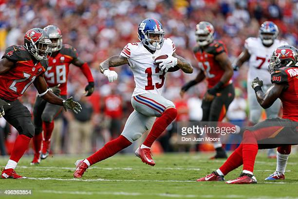 Wide Receiver Odell Beckham Jr #13 of the New York Giants makes a catch and run during the game against the Tampa Bay Buccaneers at Raymond James...