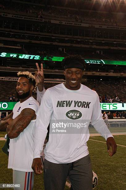 Wide Receiver Odell Beckham Jr #13 of the New York Giants posses with WIde Receiver Brandon Marshall of the New York Jets at MetLife Stadium on...