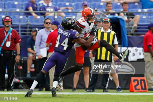 Wide Receiver Odell Beckham of the Cleveland Browns is tackled after a reception by cornerback Marlon Humphrey of the Baltimore Ravens during the...