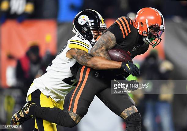 Wide receiver Odell Beckham of the Cleveland Browns is tackled by cornerback Steven Nelson of the Pittsburgh Steelers after review falls 1 yard short...