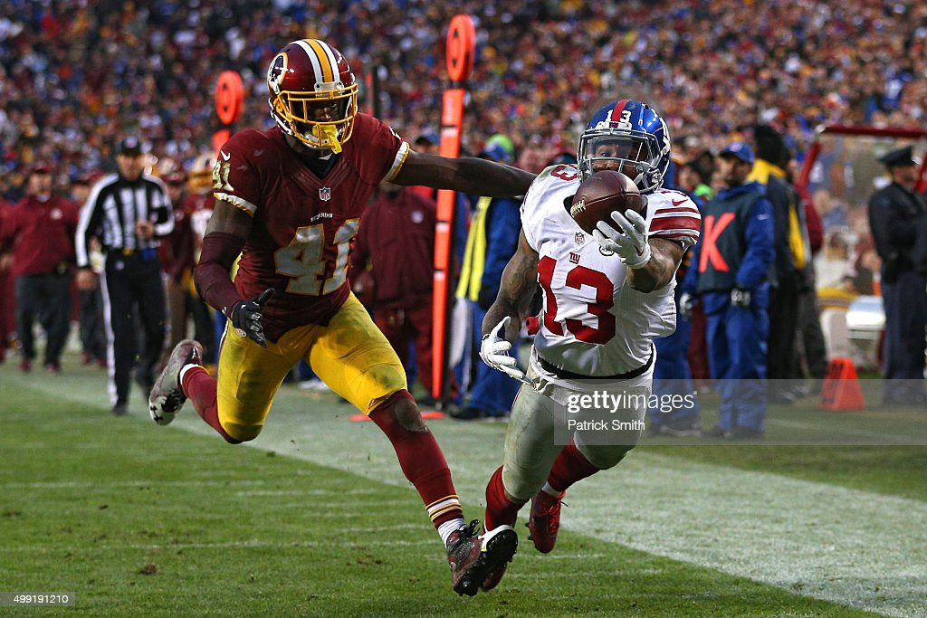 Wide receiver Odell Beckham #13 of the New York Giants scores a fourth quarter touchdown past cornerback Will Blackmon #41 of the Washington Redskins at FedExField on November 29, 2015 in Landover, Maryland.