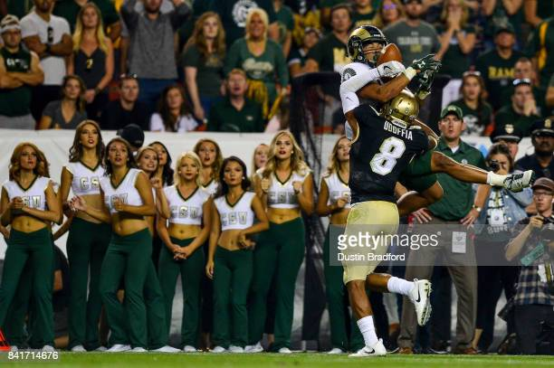 Wide receiver Olabisi Johnson of the Colorado State Rams attempts to catch a pass that is broken up by defensive back Anthony Julmisse of the...