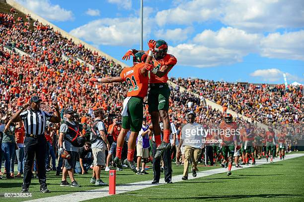 Wide receiver Olabisi Johnson of the Colorado State Rams celebrates with wide receiver Xavier Williams after a touchdown against the Northern...