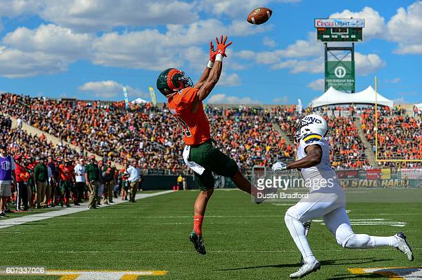 Wide receiver Olabisi Johnson of the Colorado State Rams goes up for a catch in the end zone for a touchdown against the Northern Colorado Bears at...