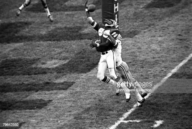 Wide receiver Otis Taylor of the Kansas City Chiefs catches a touchdown pass from quarterback Len Dawson despite the efforts of defensive back Pat...