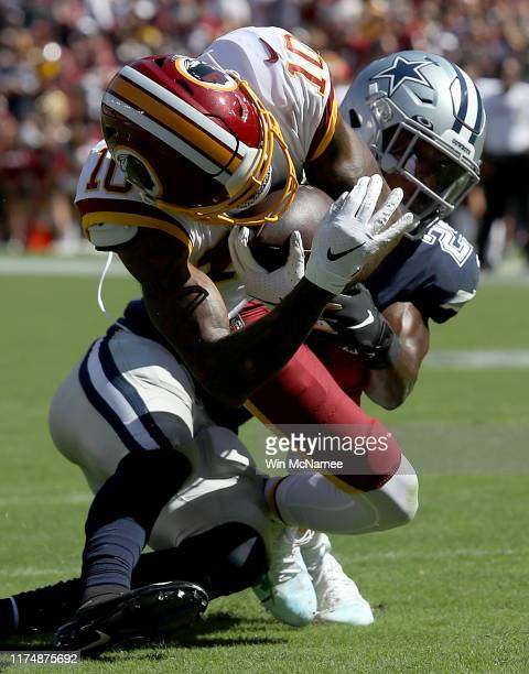 Wide receiver Paul Richardson Jr. #10 of the Washington Redskins crosses the goal line for a touchdown in the second half action as safety Xavier...