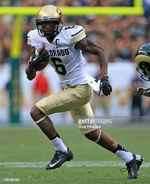 Wide receiver Paul Richardson of the Colorado Buffaloes makes a reception against the Colorado State Rams in the 2013 Rocky Mountain Showdown at...