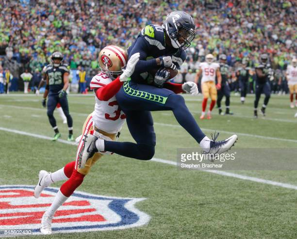Wide receiver Paul Richardson of the Seattle Seahawks beats cornerback Rashard Robinson of the San Francisco 49ers to score a 9 yard touchdown during...