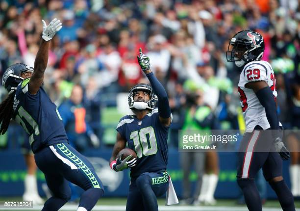 Wide receiver Paul Richardson of the Seattle Seahawks celebrates a touchdown with JD McKissic as safety Andre Hal of the Houston Texans looks on...