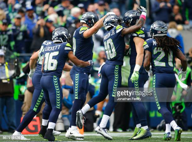 Wide receiver Paul Richardson of the Seattle Seahawks celebrates his touchdown with Nick Vannett during the first quarter of the game against the...