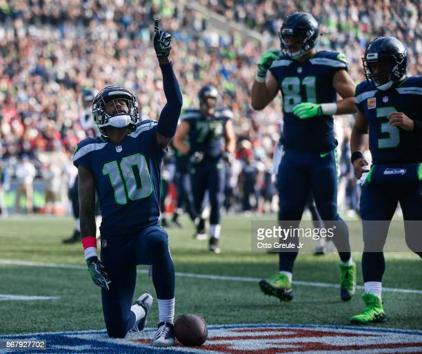 Wide receiver Paul Richardson of the Seattle Seahawks celebrates his touchdown as Nick Vannett and Russell Wilson run over to join him during the...
